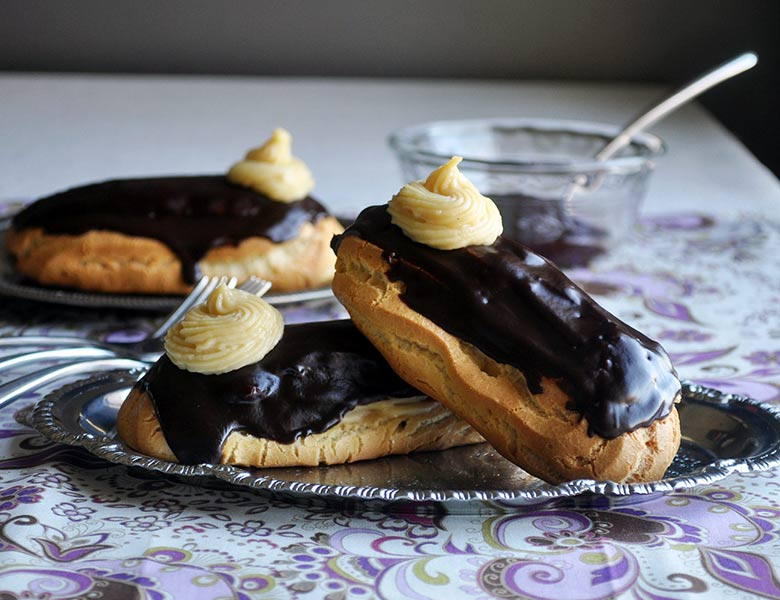 Pastry cream filled chocolate eclair dessert recipe | ofbatteranddough.com