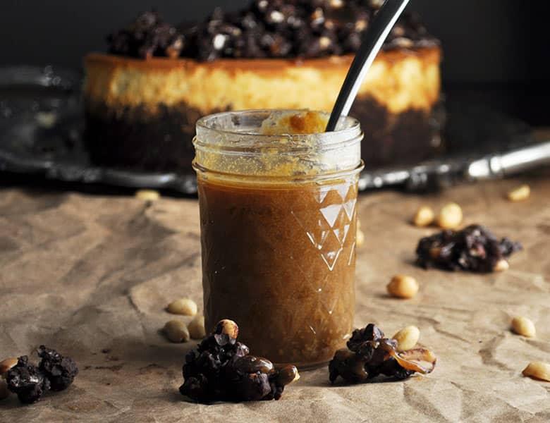 Peanut Butter Cheesecake with chocolate peanut butter crunch topping | ofbatteranddough.com