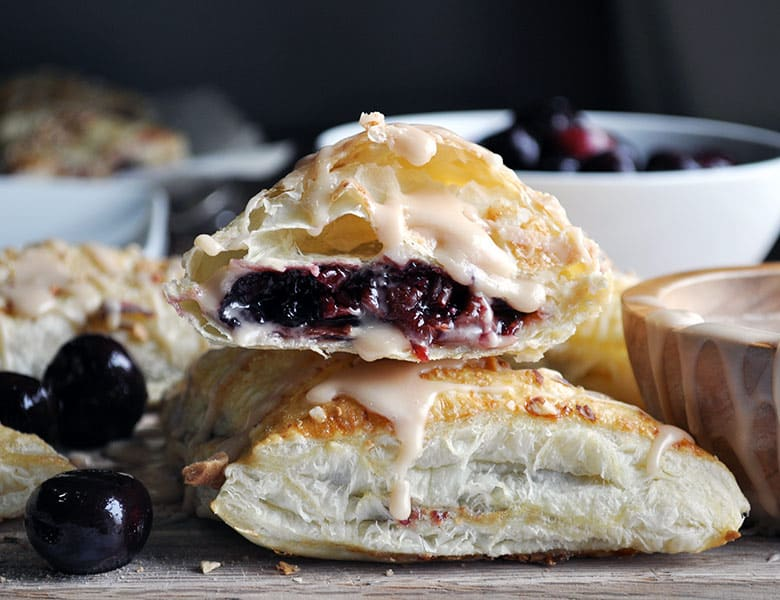 Cherry Turnovers | Cherry turnover recipe with cream cheese and almonds | ofbatteranddough.com