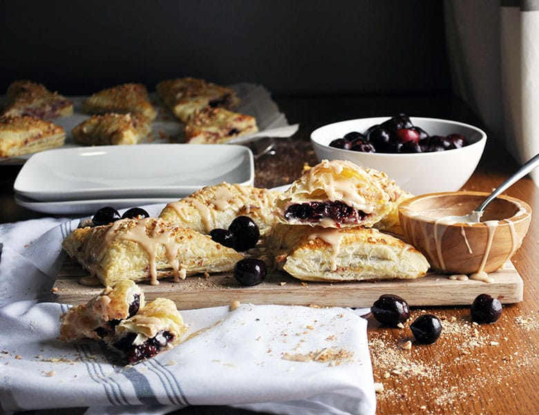 Cherry Turnovers   Cherry turnover recipe with cream cheese and almonds   ofbatteranddough.com