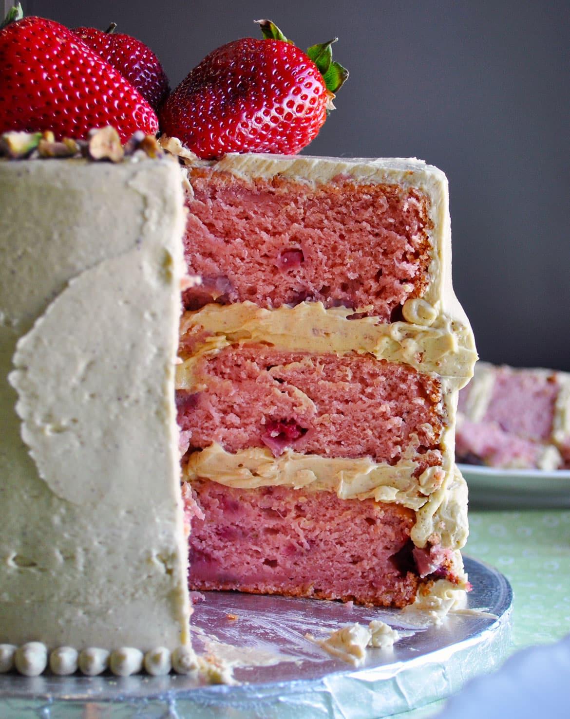 The Best fresh Strawberry Cake with Pistachio Buttercream | ofbatteranddough.com