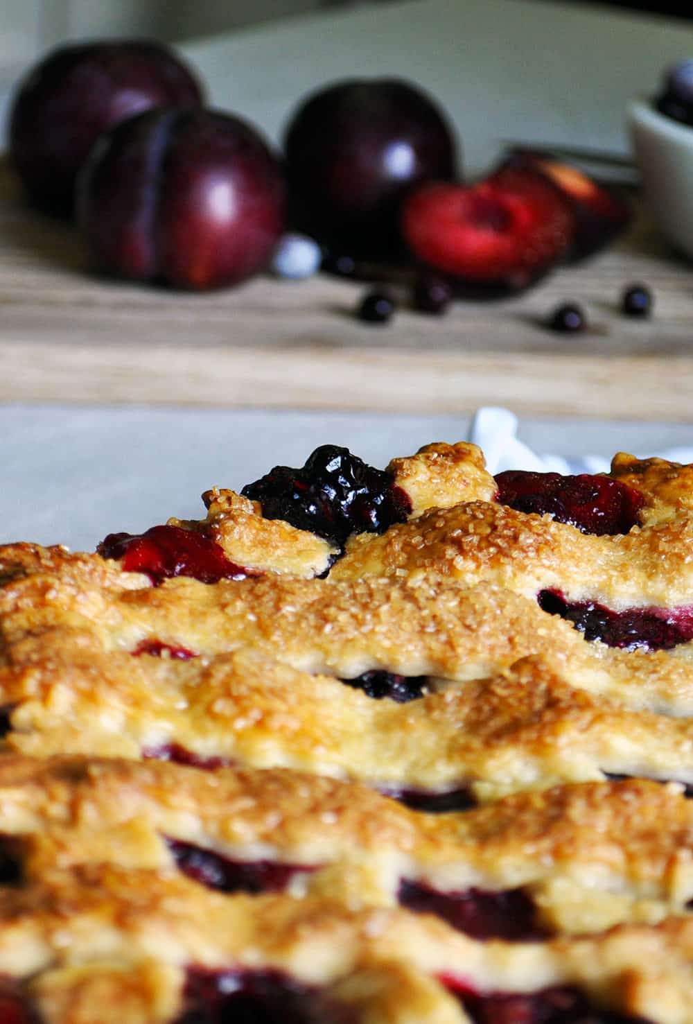 Triple Berry Plum Pie with Mixed Berries | ofbatteranddough.com