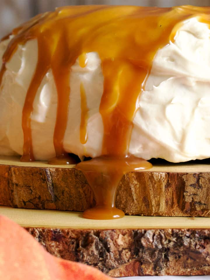 Salted Caramel Rum Sauce Dripping Down the Side of a cake.