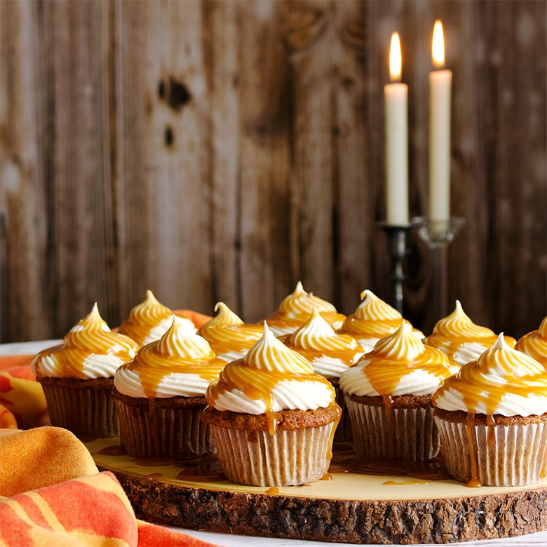 Carrot Cake Cupcakes with Cream Cheese Buttercream and Salted Caramel Rum Sauce.