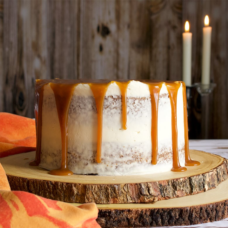 Carrot Cake Layer Cake with Cream Cheese Buttercream and Salted Caramel Rum Sauce.