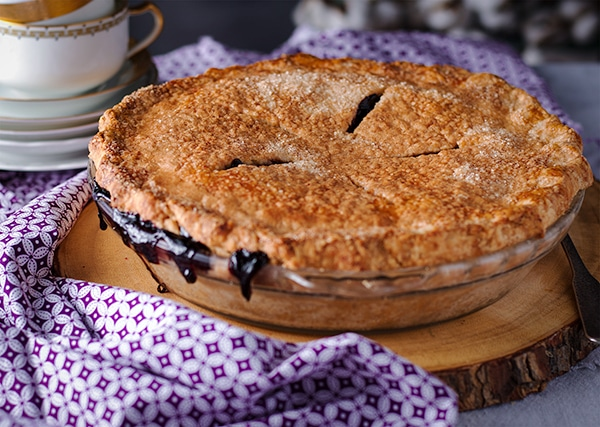 A perfect blueberry pie with a sugared crust.