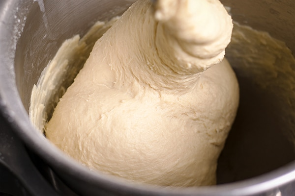 Mixing bread dough in a stand mixer.