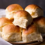 A plate full of homemade dinner rolls.