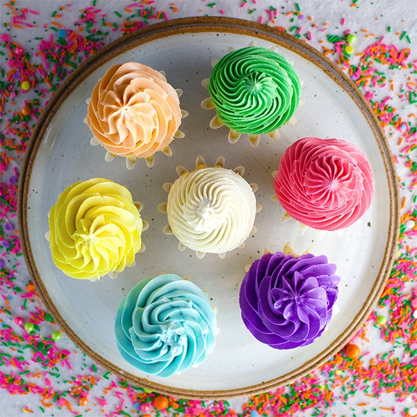 Cupcakes frosted with colorful Italian Meringue Buttercream
