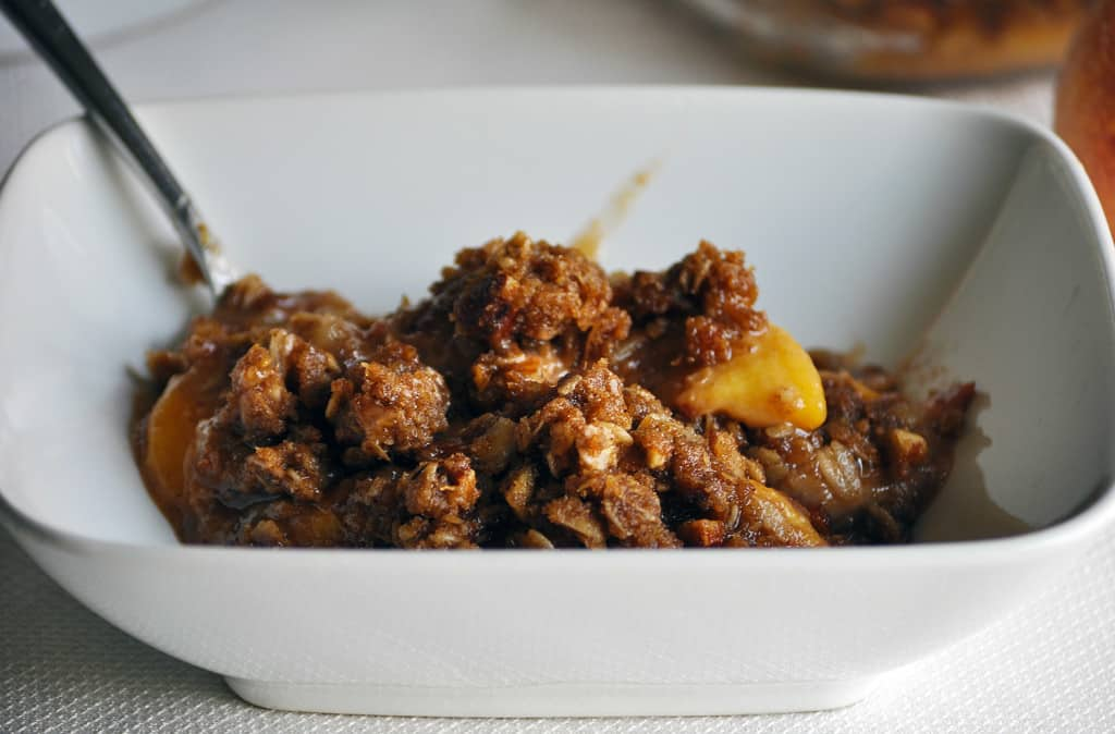 Fresh Peach Crisp Recipe. Fresh peaches topped with a buttery brown almond streusel.   OfBatterAndDough.com