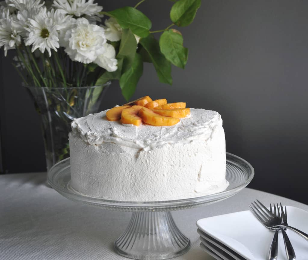 Peaches and Cream Crepe Cake. Layer upon layer of buttery crepes, vanilla pastry cream, fresh peaches and whipped cream. | OfBatterandDough.com