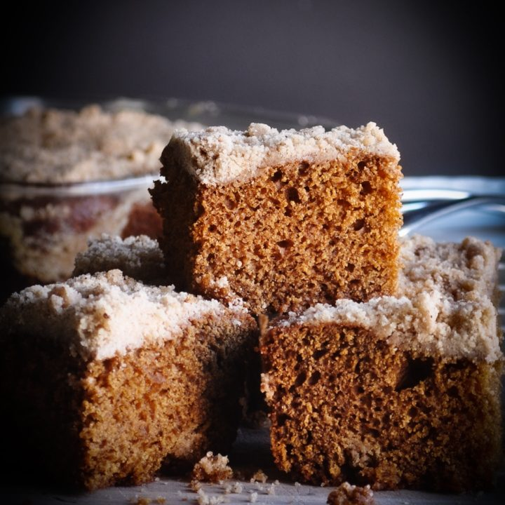 A tray of Old Fashioned Gingerbread slices stacked on a tray.