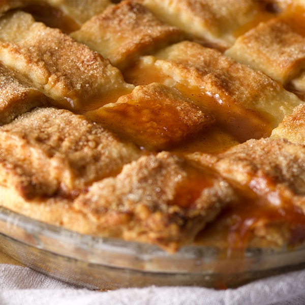 A freshly baked Peach Pie with lattice crust.