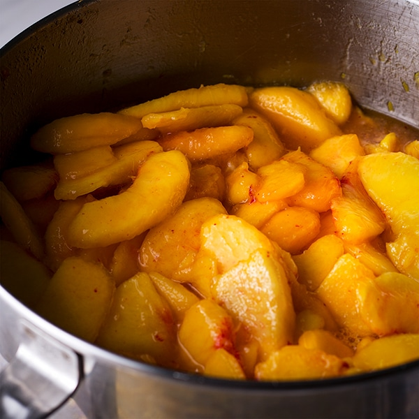 A bowl of freshly sliced peaches for homemade peach pie.