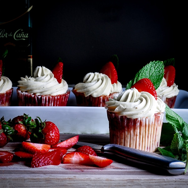 Strawberry mojito cupcakes with Italian Meringue Buttercream and fresh cut strawberries.