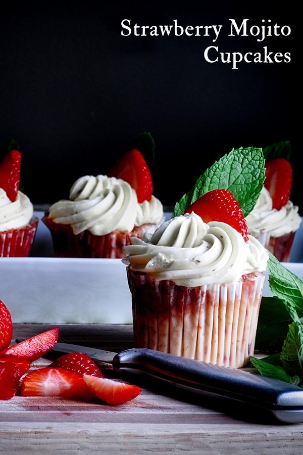 Strawberry mojito cupcakes with Italian Meringue Buttercream and fresh cut strawberries.