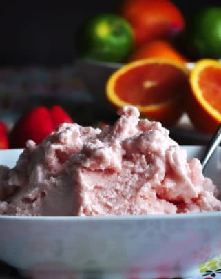 A bowl of healthy strawberry frozen yogurt.