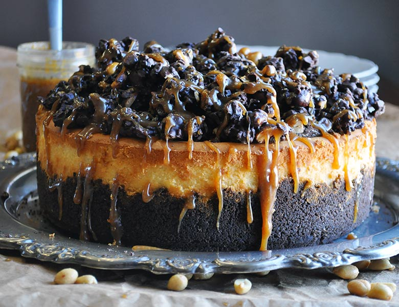 Peanut Butter Cheesecake with chocolate peanut butter crunch topping | ofbatteranddough.com