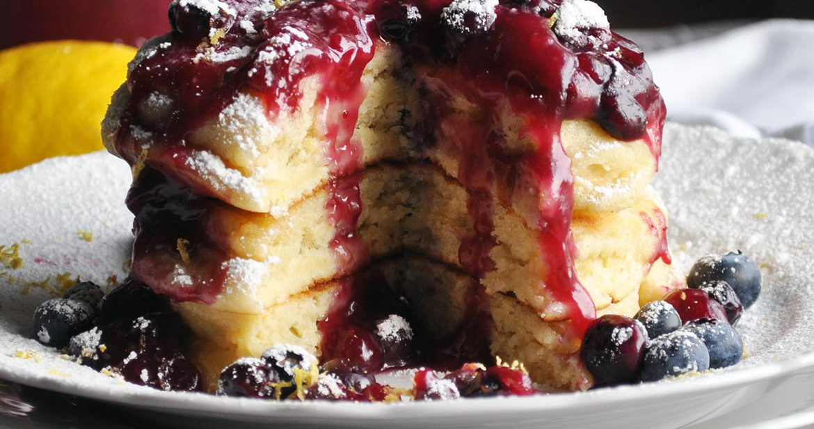 Lemon ricotta pancakes with blueberry sauce | ofbatteranddough.com