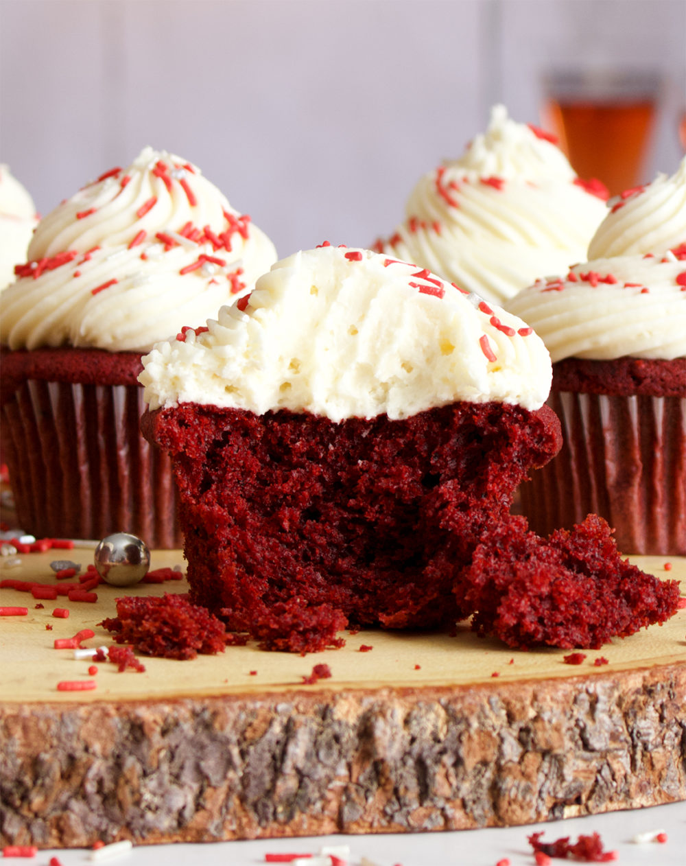 The inside of a red velvet cupcake with cream cheese buttercream.