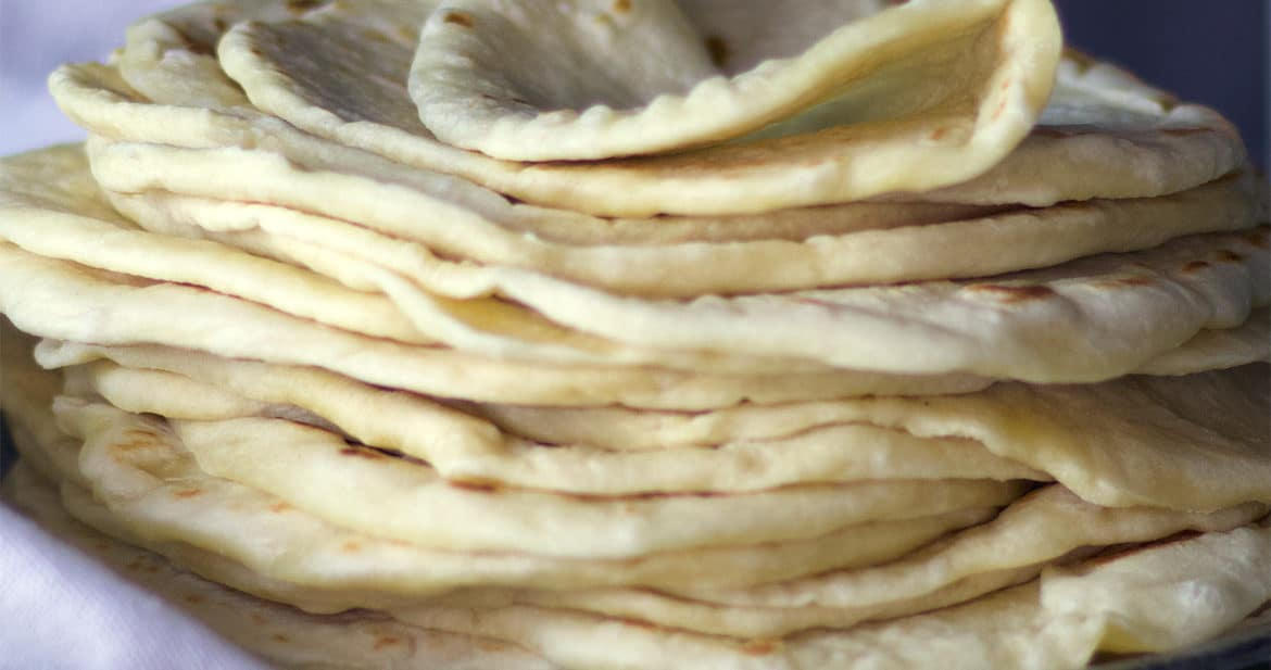 A stack of soft, easy homemade tortillas {al butter recipe}