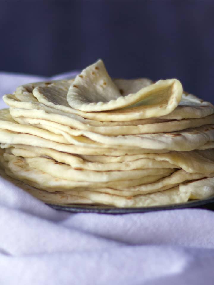A stack of soft, easy homemade tortillas {al butter recipe}