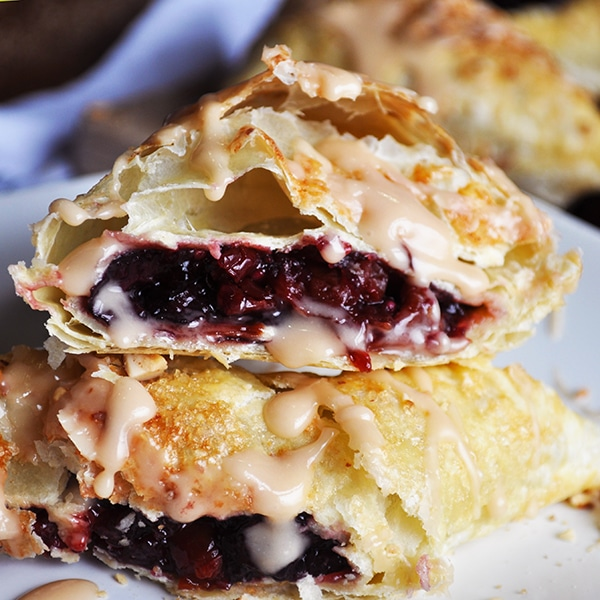 Inside a cream cheese cherry turnover with almond glaze.