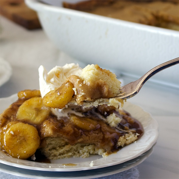 Taking a bite of Bananas Foster Butter Cake. {St. Louis Gooey Butter Cake with Bananas Foster Sauce}