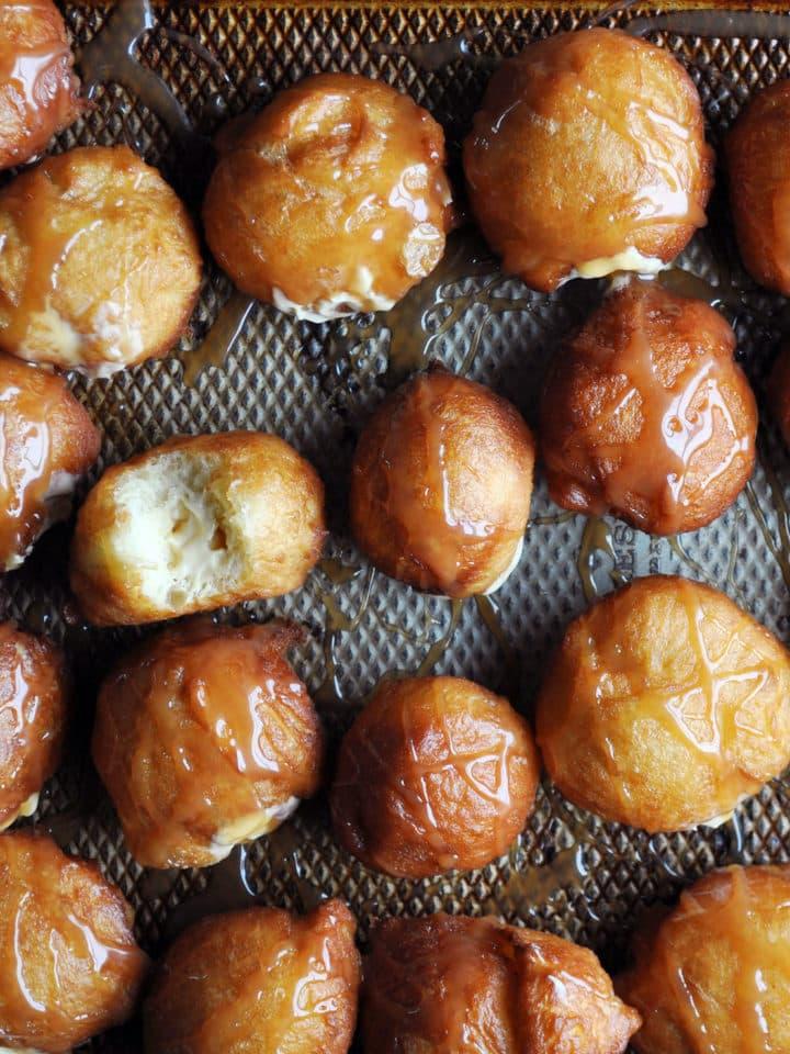 Doughnut Holes filled with Salted Caramel Pastry Cream | ofbatteranddough.com