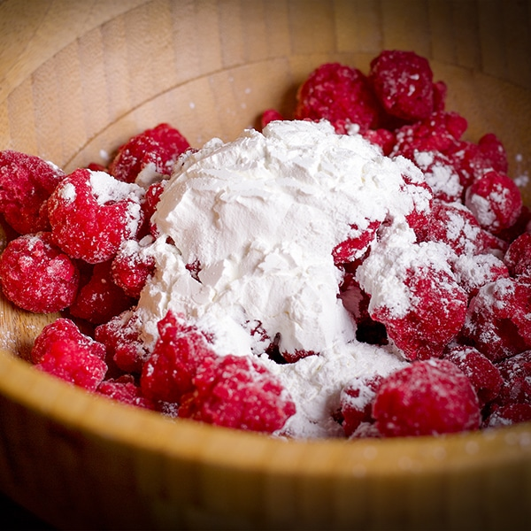 Tossing berries with cornstarch helps them not sink to the bottom while the cake bakes.