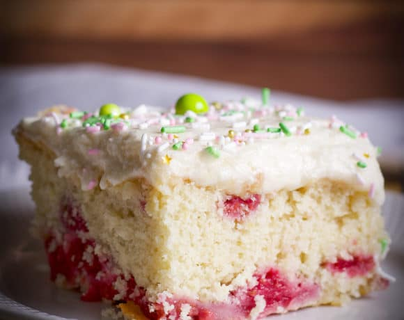 A piece of berry lemon snack cake on a plate.