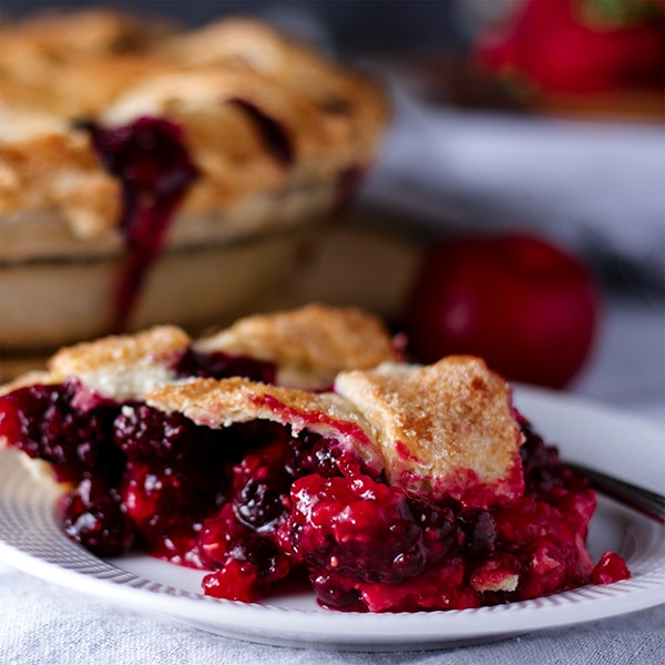 A slice of Mixed Berry Plum Pie