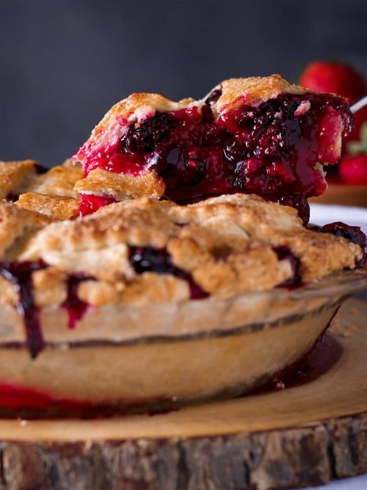 Serving a slice of Mixed Berry Plum Pie