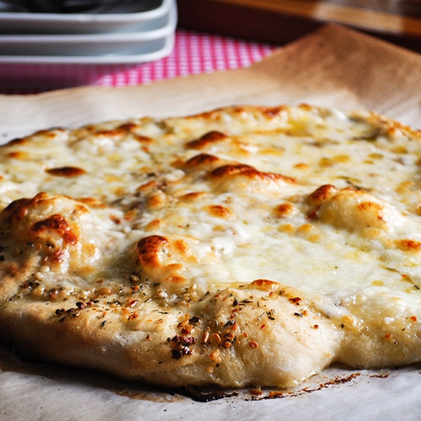 A cheese pizza made with homemade pizza dough.