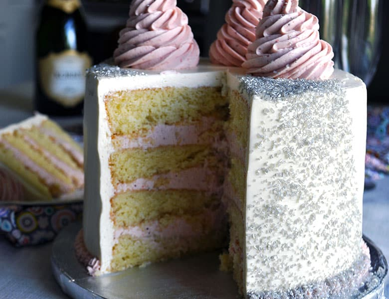 Champagne Cake with Strawberry and Champagne Italian Meringue Buttercream | ofbatteranddough.com