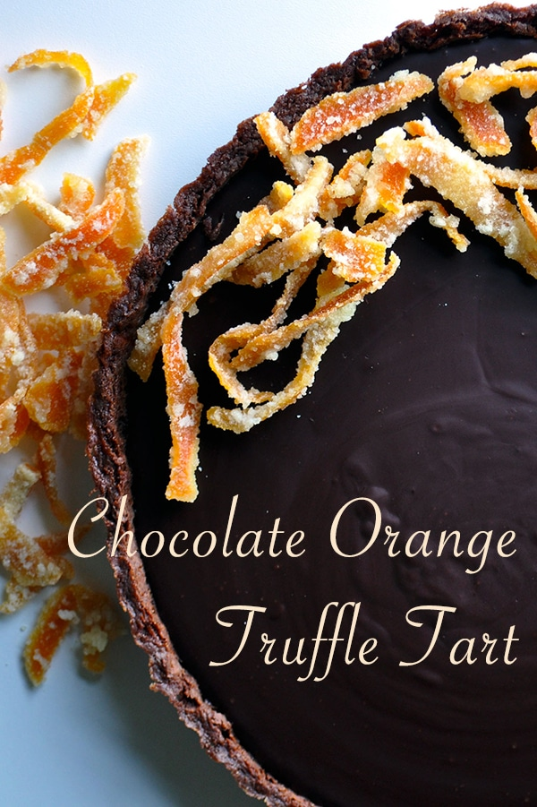 A Chocolate Orange Truffle Tart with candied orange peel.