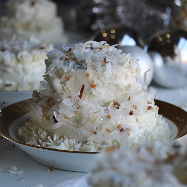 A mini Coconut Layer Cake frosted with Maple Italian Meringue Buttercream.