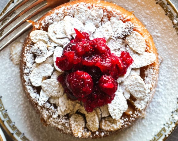 A mini Almond Cake topped with Cranberry Sauce.