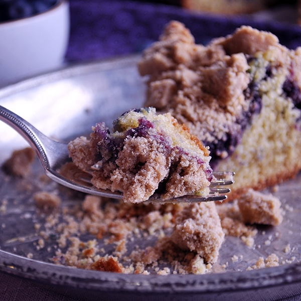Taking a bite of Blueberry Crumb Cake