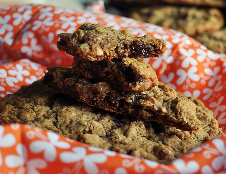 Pieces of giant chewy oatmeal raisin cookies.