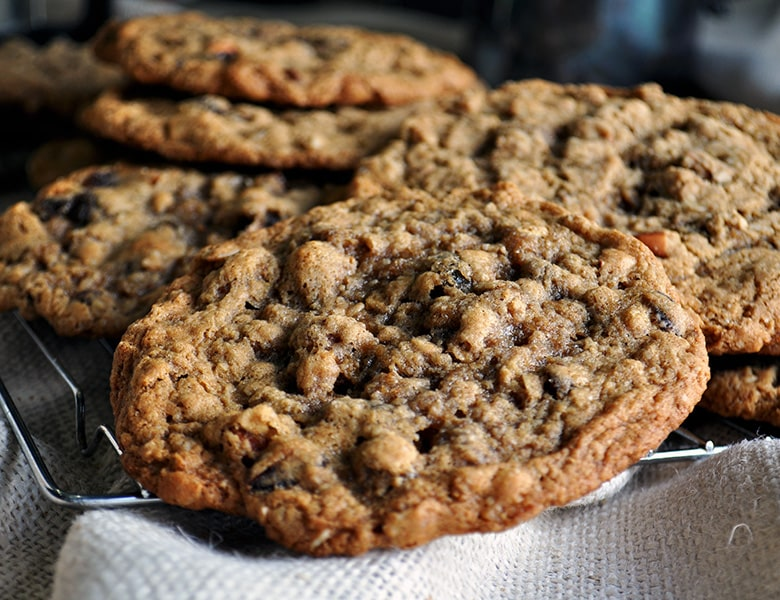 A pile of giant chewy oatmeal raisin cookies.