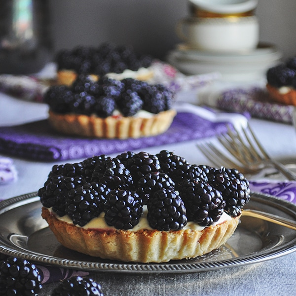 Blackberry custard fruit tarts with amaretto.