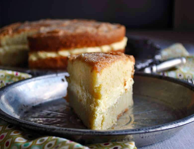 A slice of Olive Oil Cake with Lemon Mascarpone Cream Filling
