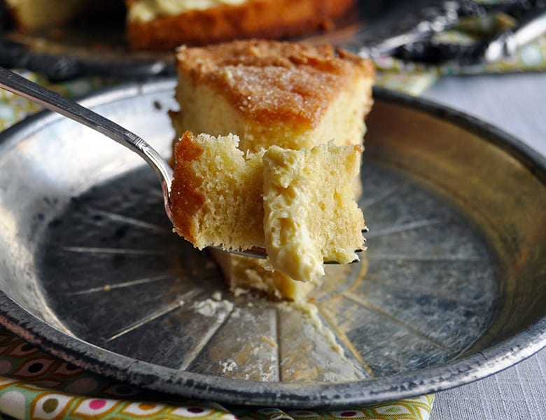 A bite of Olive Oil Cake with Lemon Mascarpone Cream Filling