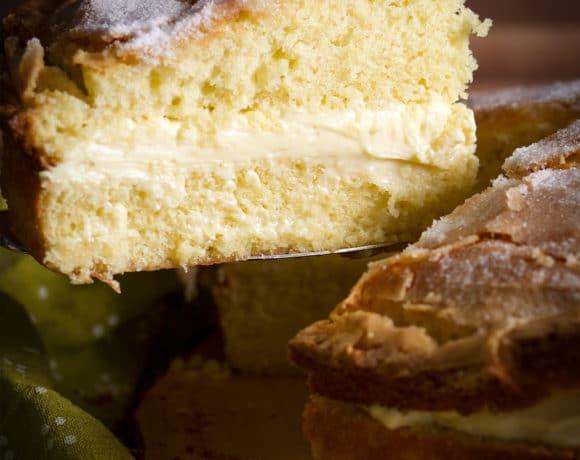 Serving a slice of Olive Oil Cake with Lemon Mascarpone Pastry Cream filling.
