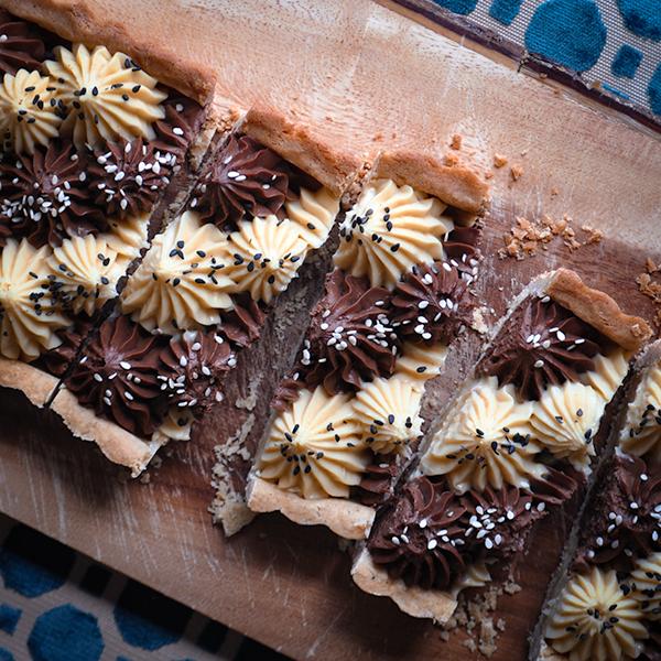 Slices of white and dark chocolate tahini tart.