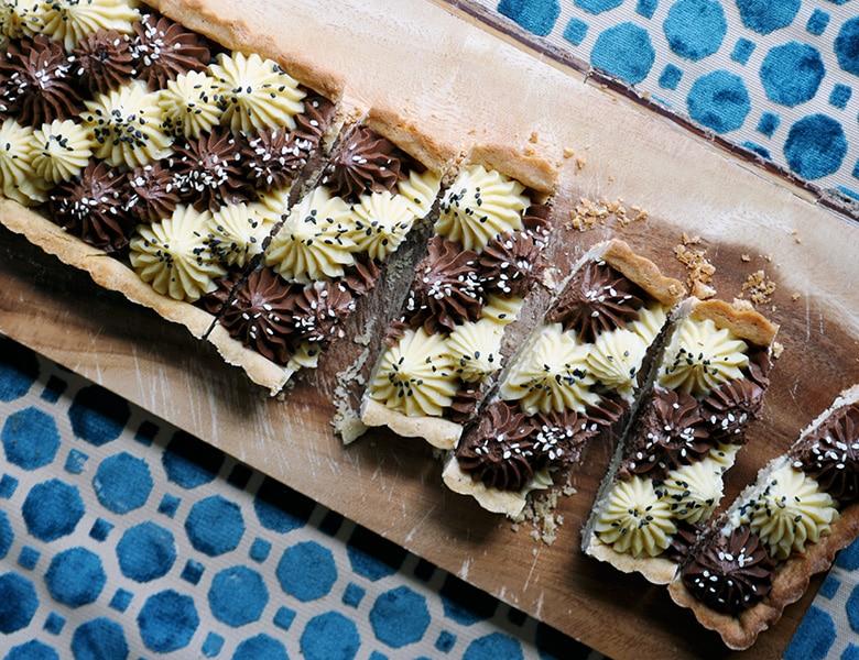 Slices of dark and white chocolate tahini tart.