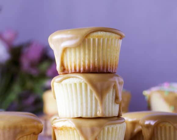 A stack of three Perfect buttermilk caramel cupcakes with caramel frosting