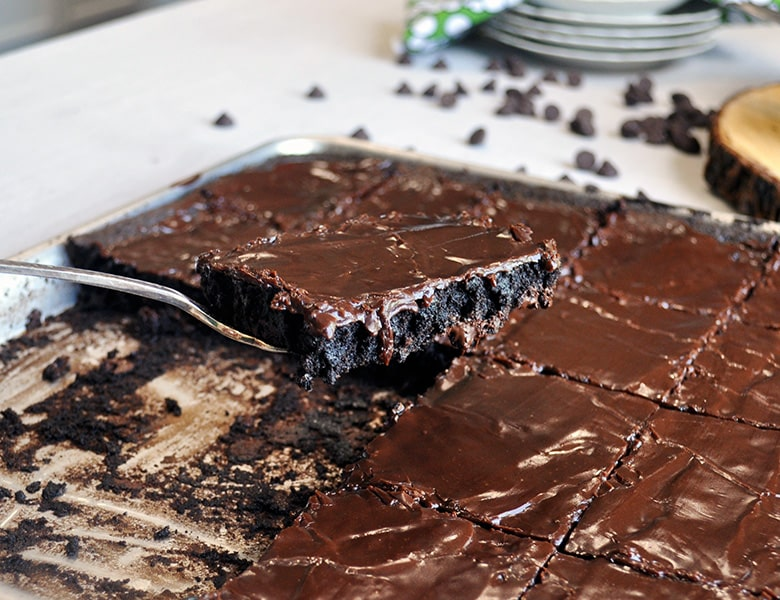 Serving up a frosted brownie | Sheet Pan Frosted Brownies for a Crowd