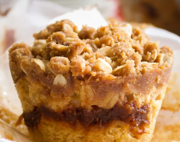 An Apple Cinnamon Muffin with the wrapper pulled down so you can see the apple butter center.